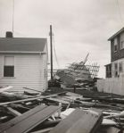 Photographs of the Aftermath in Island Park of Hurricane Carol in 1954 (10. Front Side)